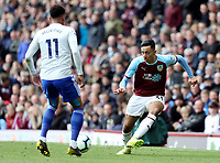 Burnley's Dwight McNeil threads a pass despite the attentions of Cardiff City's Josh Murphy<br /> <br /> Photographer Rich Linley/CameraSport<br /> <br /> The Premier League - Saturday 13th April 2019 - Burnley v Cardiff City - Turf Moor - Burnley<br /> <br /> World Copyright © 2019 CameraSport. All rights reserved. 43 Linden Ave. Countesthorpe. Leicester. England. LE8 5PG - Tel: +44 (0) 116 277 4147 - admin@camerasport.com - www.camerasport.com