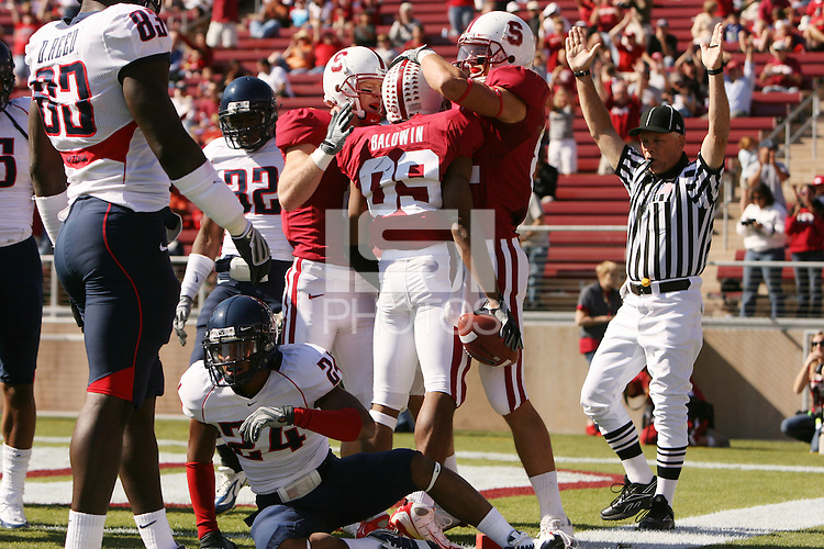 STANFORD, CA - OCTOBER 11:  Doug Baldwin of the Stanford Cardinal celebrates with Ryan Whalen and Coby Fleener during Stanford's 24-23 win over the Arizona Wildcats on October 11, 2008 at Stanford Stadium in Stanford, California.