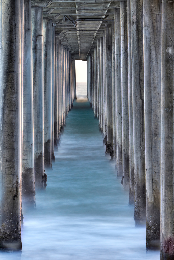 Symmetric columns create an eerie scene into the sea of the Huntington Beach pier, Los Angeles, California.