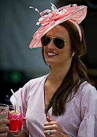 LOUISVILLE, KY - MAY 03: A woman drinks an Oaks Lily while wearing a matching pink fascinator during Thurby at Churchill Downs on May 3, 2018 in Louisville, Kentucky. (Photo by Scott Serio/Eclipse Sportswire/Getty Images)