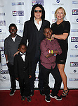 Gene Simmons and Shannon Tweed-Simmons with patients of Mending Kids at the Mending Kids Gala Honoring Gene Simmons and family, held at the Santa Monica Airport Hanger 8 on November 9, 2013