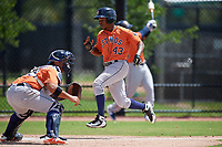 Houston Astros Juan Ramirez (43) scores a run during a Minor League Spring Training Intrasquad game on March 28, 2019 at the FITTEAM Ballpark of the Palm Beaches in West Palm Beach, Florida.  (Mike Janes/Four Seam Images)