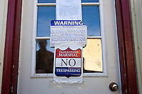 No trespassing signs were taped to the doors on all caves storing cheese at the Estrella Family Creamery in Montesano,Wash.  on November 4, 2010.  The Food and Drug Administration ordered the Estrella Family Creamery in Montesano,Wash.  to stop processing cheeses after it found listeria bacteria on some of the cheeses this year.  The family says they have made many renovations on the farm and the bacteria is only found on the soft cheese, not everything.  They believe they should be allowed to resume making cheese and sell the hard cheeses they have already made at the facility.  The creamery is one of Washington's most famous artisan cheesemakers.  (photo credit Karen Ducey). .