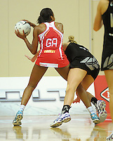 Pamela Cookey takes a pass under pressure from Casey Williams during the New World Quad Series international Netball match between New Zealand Silver Ferns and England at TSB Bank Arena, Wellington, New Zealand on Thursday, 25 October 2012. Photo: Dave Lintott / lintottphoto.co.nz