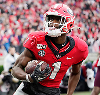 ATHENS, GA - NOVEMBER 23: George Pickens #1 of the Georgia Bulldogs celebrates after a touchdown catch during a game between Texas A