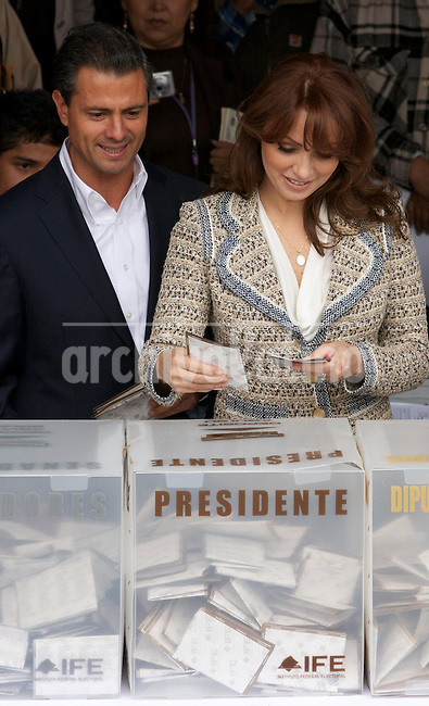 Enrique Pena Nieto of the Institutional Revolutionary Party (PRI) and his wife Angelica Rivera cast their vote inn Atlacomulco , near Mexico City, July 1, 2012.