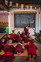 Monk teaching young novice monks at a Buddhist temple at Pindaya, Shan State, Myanmar (Burma)