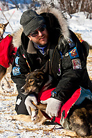 Veterinarian Mike Walker examines a Peter Kaiser dog at the Kaltag checkpoint during the 2010 Iditarod