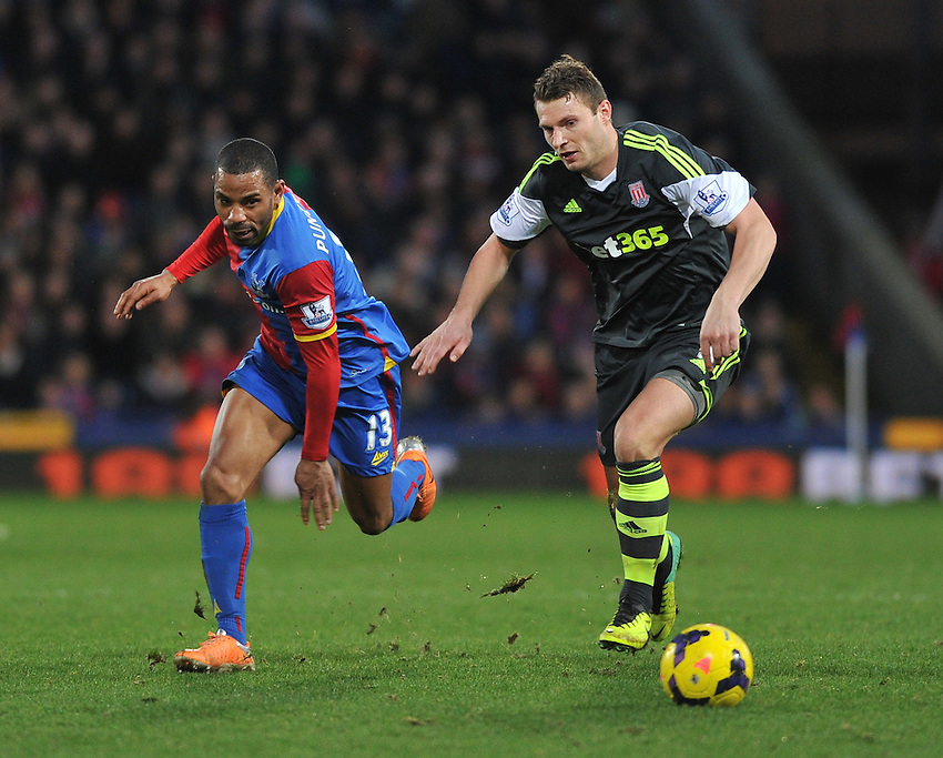 Crystal Palace's Jason Puncheon battles with Stoke City's Erik Pieters<br /> <br /> Photo by Ashley Western/CameraSport<br /> <br /> Football - Barclays Premiership - Crystal Palace v Stoke City - Saturday 18th January 2014 - Selhurst Park - London<br /> <br /> &copy; CameraSport - 43 Linden Ave. Countesthorpe. Leicester. England. LE8 5PG - Tel: +44 (0) 116 277 4147 - admin@camerasport.com - www.camerasport.com
