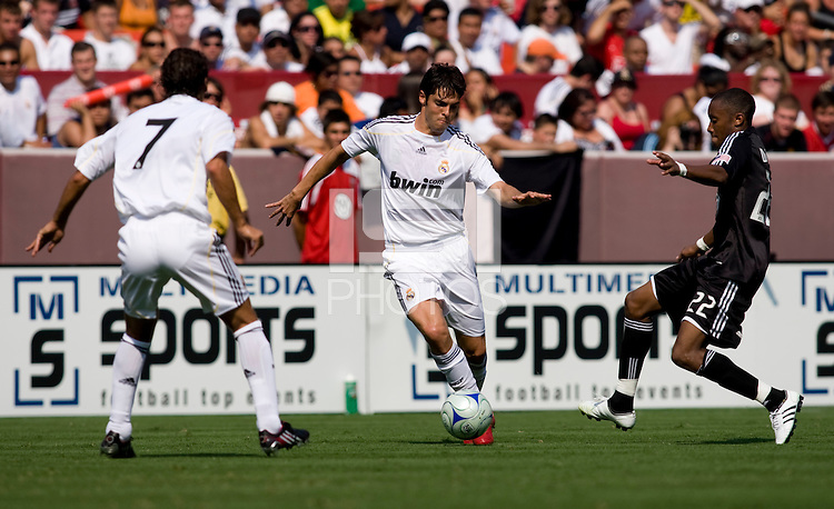 Real Madrid forward (8) Kaka passes to teammate (7) Raul as DC United midfielder (22) Rodney Wallace moves in during their friendly at FedEx Field in Landover, Maryland.  Real Madrid defeated DC United, 3-0.