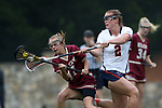 CHAPEL HILL, NC - MAY 12: Virginia's Kasey Behr (2) tries to knock the ball away from Elon's Abby Godfrey (11). The Elon University Phoenix played the University of Virginia Cavaliers on May 12, 2017, at Fetzer Field in Chapel Hill, NC in an NCAA Women's Lacrosse Tournament First Round match. Virginia won the game 11-9.
