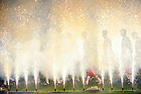 Players enter the field as fireworks go off prior to the game. The New York Red Bulls defeated the Seattle Sounders 1-0 during a Major League Soccer (MLS) match at Red Bull Arena in Harrison, NJ, on March 19, 2011.