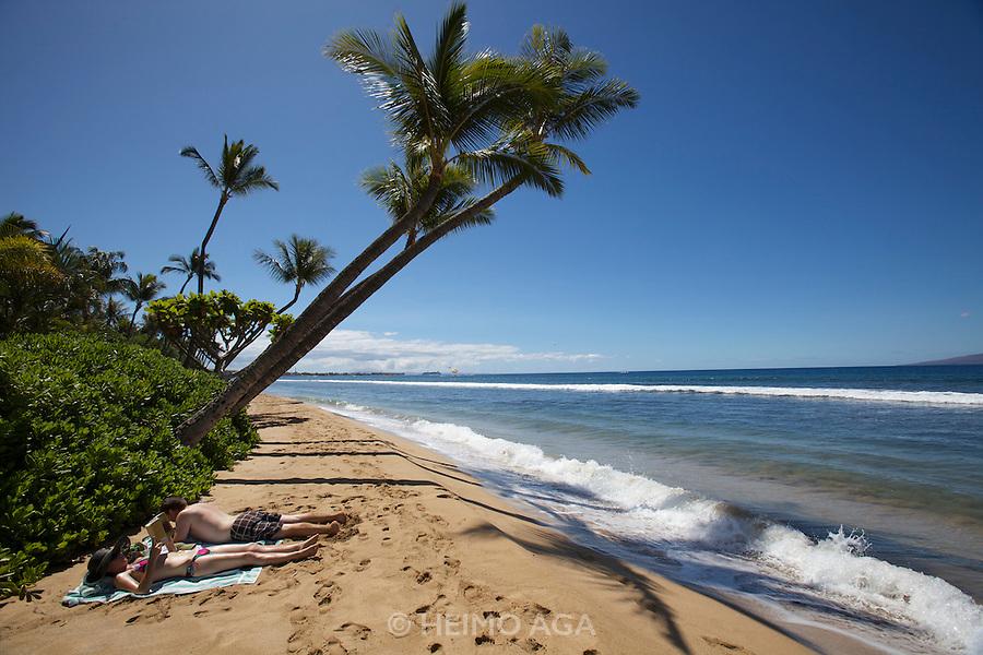 Maui, sunbathers at Ka'anapali Beach.