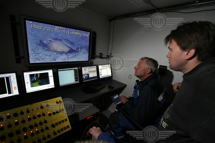 Fredrik Søreide watches as Thor Olav Sperre operates the ROV towards ceramics found on the seaved. ©Fredrik Naumann/Felix Features