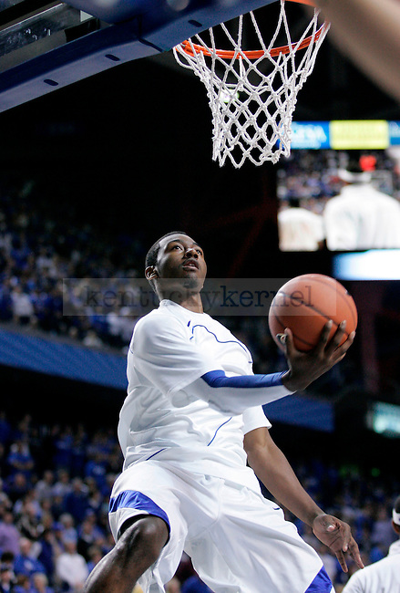 Freshman guard John Wall warms up before the game against the Rider Broncs at Rupp Arena on Saturday. Photo by Zach Brake | Staff