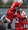 Jayvian Allen #2 of Freeport gets hoisted into the air by Makhai Jinks #52 after catching a pass for a touchdown in the second quarter of the Class I Long Island Championship against Floyd at Shuart Stadium in Hempstead on Saturday, Nov. 24, 2018.