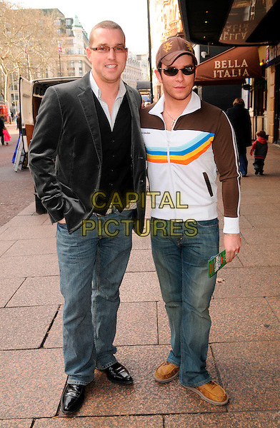 "STEPHEN GATELY & GUEST.The ""Horton Hears A Who"" VIP screening, Vue West End cinema, London, England..March 2nd, 2008.full length black jacket brown white hat sunglasses shades partner couple jeans denim .CAP/CAN.©Can Nguyen/Capital Pictures."
