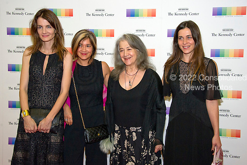 Argentine pianist Martha Argerich, center right, arrives with her daughters, from left, Anne Catherine Dutoit, Lyda Chen,Stephanie Argerich. for the formal Artist's Dinner honoring the recipients of the 39th Annual Kennedy Center Honors hosted by United States Secretary of State John F. Kerry at the U.S. Department of State in Washington, D.C. on Saturday, December 3, 2016. The 2016 honorees are: Argentine pianist Martha Argerich; rock band the Eagles; screen and stage actor Al Pacino; gospel and blues singer Mavis Staples; and musician James Taylor.<br /> Credit: Ron Sachs / Pool via CNP