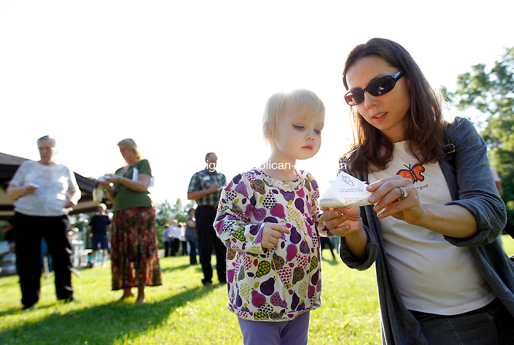 Watertown, CT-13 June 2012-061312CM05-  Rebecca Mehegan (right) and her daughter Sophie, 2, of Woodbury release a butterfly  during the 4th annual Butterfly Release: A Celebration of Hope at Crestbrook Golf Course Wednesday afternoon in Watertown.  The event put on by the VNA Health at Home, Inc. is held for members of the community to honor a loved one by sponsoring a Monarch butterfly in their name.   After a brief ceremony, supporters released the butterflies into the air.  As a symbolism of of the cycle of life, the butterflies and their release represent an expression of strength and hope.  Christopher Massa Republican-American