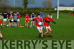 Eoghan Hassett of ISK Killorglin about to kick as Shane Kingston of Bishopstown, looks on in the Frewen Cup in Currans on Friday.
