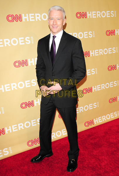 ANDERSON COOPER.at The 3rd Annual CNN Heroes: An All-Star Tribute held at The Kodak Theatre in Hollywood, California, USA,  November 21st 2009                                                                   .full length black suit purple tie white shirt .CAP/RKE/DVS.©DVS/RockinExposures/Capital Pictures