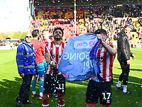 Bruno Andrade, left, and Shay McCartan celebrate promotion at the end of the game<br /> <br /> Photographer Andrew Vaughan/CameraSport<br /> <br /> The EFL Sky Bet League Two - Lincoln City v Cheltenham Town - Saturday 13th April 2019 - Sincil Bank - Lincoln<br /> <br /> World Copyright &copy; 2019 CameraSport. All rights reserved. 43 Linden Ave. Countesthorpe. Leicester. England. LE8 5PG - Tel: +44 (0) 116 277 4147 - admin@camerasport.com - www.camerasport.com
