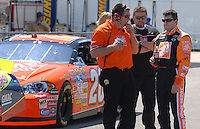 Apr 28, 2007; Talladega, AL, USA; Nascar Nextel Cup Series driver Tony Stewart (20) talks with crew members during qualifying for the Aarons 499 at Talladega Superspeedway. Mandatory Credit: Mark J. Rebilas