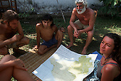 Chapada dos Guimaraes, Mato Grosso, Brazil. Ed Posey, Liz Hosken, Mario Friedlander and Jorge with a map of brazil; 1990.