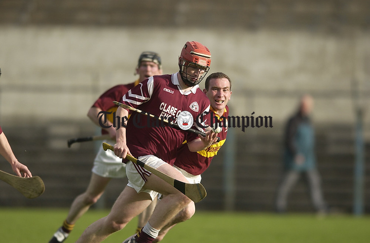 Emmet Whelan of St Joseph's is tackled by Brian Quinn of Tulla during their game in Ennis. Photograph by John Kelly.