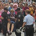 Cindy Sheehan being arrested outside the Whitehouse.
