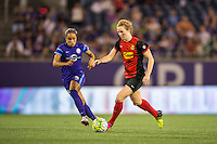 Orlando, Florida - Sunday, May 14, 2016: Western New York Flash midfielder Samantha Mewis (5) protects the ball from Orlando Pride defender Monica Hickman Alves (21) during a National Women's Soccer League match between Orlando Pride and New York Flash at Camping World Stadium.