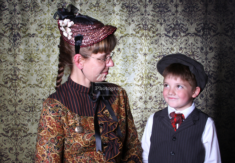 A victorian woman and boy