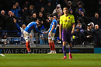 Ronan Curtis of Portsmouth left bows to John Marquis of Portsmouth who scored the third and winning goal during Portsmouth vs Exeter City, Leasing.com Trophy Football at Fratton Park on 18th February 2020