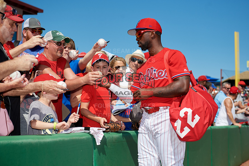 Philadelphia Phillies left fielder Andrew McCutchen (22) signs autographs for fans before a Grapefruit League Spring Training game against the Baltimore Orioles on February 28, 2019 at Spectrum Field in Clearwater, Florida.  Orioles tied the Phillies 5-5.  (Mike Janes/Four Seam Images)