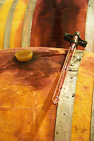 Cave P et Andre Perret in Chavannay, making Condrieu, Saint Joseph, Cote Rotie.  In the winery. On top of a barrique a pipette for taking samples  Andre André P et A Perret, Chavanay, Rhone, France, Europe