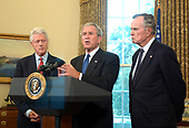 Washington, D.C. - September 1, 2005 -- United States President George W. Bush, center, announces the appointment of former United States President Bill Clinton, left, and former United States President George H.W. Bush as co-chairs of an effort to raise money to help those affected by Hurricane Katrina.<br /> Credit: Ron Sachs - Pool via CNP