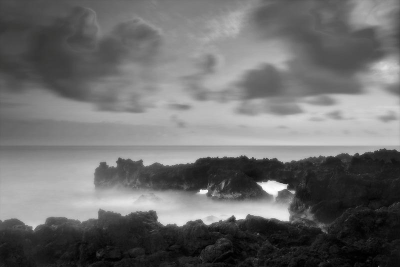 Coastline and waves with arch from Waiananappa Trail. Maui, Hawaii
