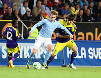 Thursday 08 August 2013<br /> Pictured: Ki Sung Yueng of Swansea (R) marking Emil Forsberg of Malmo (L)<br /> Re: Malmo FF v Swansea City FC, UEFA Europa League 3rd Qualifying Round, Second Leg, at the Swedbank Stadium, Malmo, Sweden.