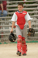 Catcher Nic Taylor walks back to the dugout during a Little League game at Memorial Park in Belton, Missouri on May 6, 2006.