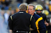 18 September 08: West Virginia coach Bill Stewart and Colorado coach Dan Hawkins (facing away) prior to a game against Colorado. The Colorado Buffaloes defeated the West Virginia Mountaineers 17-14 in overtime at Folsom Field in Boulder, Colorado. For Editorial Use Only.