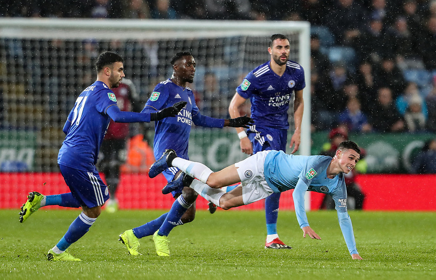 Manchester City's Phil Foden competing with Leicester City's Rachid Ghezzal<br /> <br /> Photographer Andrew Kearns/CameraSport<br /> <br /> English League Cup - Carabao Cup Quarter Final - Leicester City v Manchester City - Tuesday 18th December 2018 - King Power Stadium - Leicester<br />  <br /> World Copyright © 2018 CameraSport. All rights reserved. 43 Linden Ave. Countesthorpe. Leicester. England. LE8 5PG - Tel: +44 (0) 116 277 4147 - admin@camerasport.com - www.camerasport.com