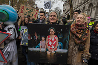 Extinction Rebellion hold a march in London demanding government action over climate change. Several thousand people marched from Parlaiment square to Buckingham palace to deliver a coffin to the Queen. 24-11-18