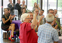 NWA Democrat-Gazette/DAVID GOTTSCHALK   Martha McNair (center), a 2017 Fayetteville Schools Hall of Honor inductee, raises her hand to be acknowledged Thursday, August 10, 2017, during the formal announcement of the 21st Annual Hall of Honor Inductees at Fayetteville High School. The announcement of the inductees by the Fayetteville Public Education Foundation also included 2017 inductee Kathleen DuVal and Laura Underwood.