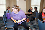 "March 11, 2010. Raleigh, North Carolina.. The first N.C. Poverty Simulation Experience training session was held at the 40th Annual State Head Start Conference at the Raleigh Convention Center.  . Nearly 60 individuals, including staff and parents from Head Start programs and Community Action Agencies, engaged in role playing exercises that hoped to simulate the experience of being poor and what the poor go through on a daily basis.. The ""thief"" steals from one of the ""family"" members."