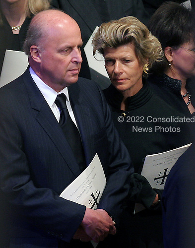 Director of National Intelligence John Negroponte and his wife, Diana, attend the State Funeral for former United States President Gerald R. Ford at the Washington National Cathedral, in Washington, D.C. on Tuesday, January 2, 2007..Credit: Ron Sachs / CNP.[NOTE: No New York Metro or other Newspapers within a 75 mile radius of New York City].