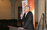 Coach Brian Newhall '83<br /> Now in his 30th year as Oxy's head men's basketball coach, Brian Newhall received a much deserved celebration with a surprise halftime ceremony and post game reception in the Booth Hall courtyard with more than 70 former and current players from all different generations and decades in attendance, on Saturday, Jan. 26, 2019.<br /> Newhall is the winningest coach in Oxy history and has a 100 percent graduation rate in his 30 years at the helm of the program. His resume boasts multiple SCIAC Championships and NCAA Playoff appearances, along with a run to the NCAA Division III Elite Eight in 2003 and the only perfect 14-0 season in SCIAC history. Newhall has not only coached at Oxy, but was a SCIAC Champion and SCIAC Player of the Year during his playing career at Oxy in the early 80s.<br /> (Photo by Marc Campos, Occidental College Photographer)