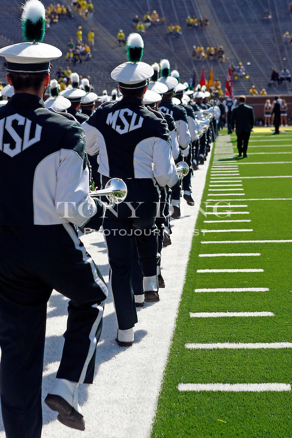 The Michigan State marching band enter Michigan Stadium before an NCAA college football game with Michigan, Saturday, Oct. 9, 2010, in Ann Arbor, Mich. (AP Photo/Tony Ding)