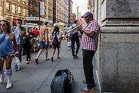 New York, NY - 7 July 2014 - Man playing a trumpet on Broadway in Soho ©Stacy Walsh Rosenstock/Alamy