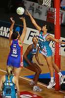 20.03.2010 Mystics Catherine Latu and Thunderbirds Mo'onia Gerrard in action during the ANZ Champs Netball match between the Mystics and Thunderbirds at Trusts Stadium in Auckland. Mandatory Photo Credit ©Michael Bradley.