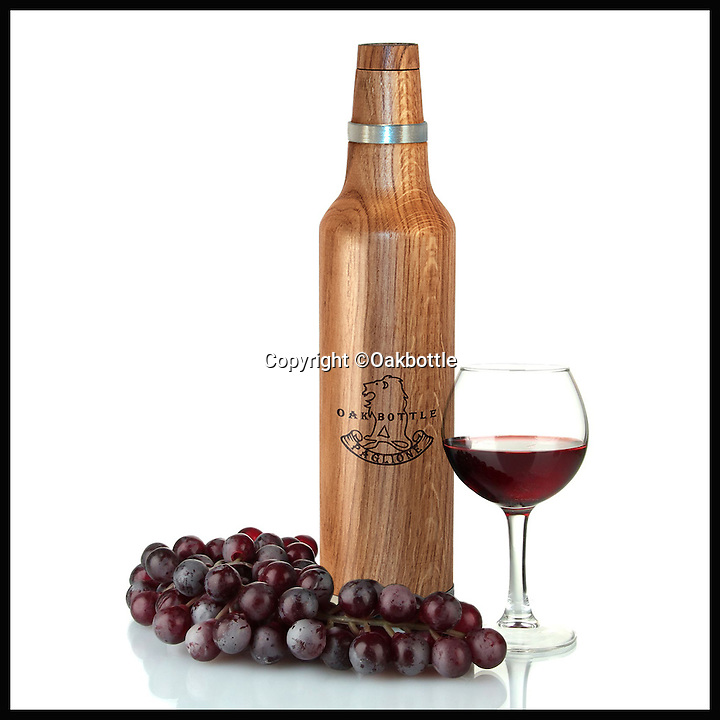 BNPS.co.uk (01202 55883)<br /> Pic: Oakbottle/BNPS<br /> <br /> *Please use full byline*<br /> <br /> The Oakbottle, and wine.<br /> <br /> This simple wooden bottle could be about to change the face of the lucrative drinks industry - because it promises to turn cheap booze into more expensive vintage-tasting drinks.<br /> <br /> The oak bottle replicates the ageing process of wines and spirits during which they sit in oak barrels and develop their flavour - but instead of taking months or years its makers say it takes as little as 24 hours to achieve the same effect.<br /> <br /> It means drinks lovers could potentially enjoy the oaky flavours of premium tipples without having to fork out the high prices they demand.  <br /> <br /> The original Oak Bottle, made from sustainably sourced American oak, costs $79.99 - around &pound;50 - from oakbottle.com.